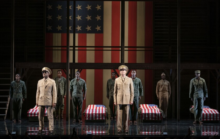 """This image released by Polk & Co. shows the cast during a performance of """"A Soldier's Play,"""" in New York. Costume designer Dede Ayite is nominated for two 2021 Tony Awards for costume design for """"Slave Play"""" and """"A Soldier's Play."""" (Joan Marcus/Polk & Co. via AP)"""