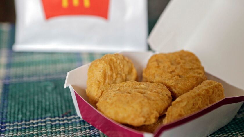 FILE - In this March 4, 2015, file photo, an order of McDonald's Chicken McNuggets is displayed for
