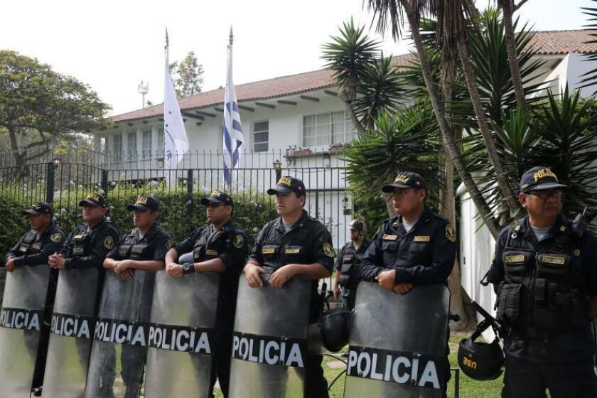 A photo provided by Peru's Andina news agency that shows a group of police officers on Nov. 19, 2018, guarding the Lima residence of Uruguay's ambassador to Peru. Peruvian lawmakers on Nov. 19 expressed outrage at former President Alan Garcia's request for political asylum in Uruguay. Garcia faces graft allegations in his homeland. EPA-EFE/Norman Cordova/AGENCIA ANDINA