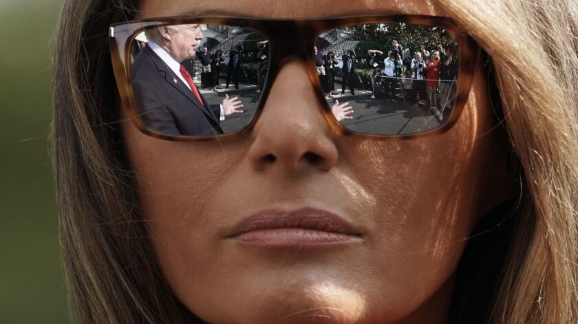 President Trump's reflection is seen in First Lady Melania Trump's sunglasses.
