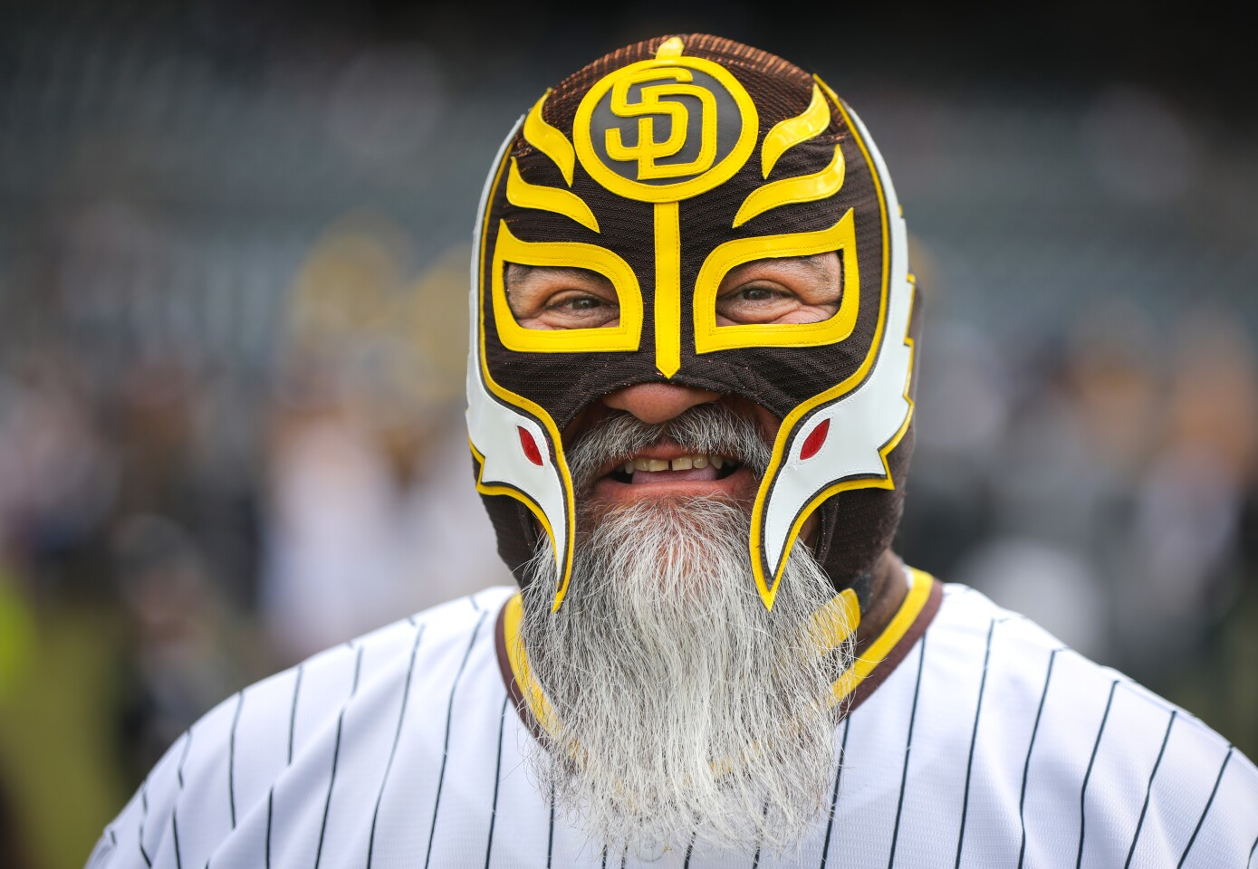 San Diego Padres fan Jose Rodriguez of Palm City gets in the spirit of the coming baseball season by wearing his lucha libre mask during Padres FanFest 2020, January 11, 2020 at Petco Park in San Diego, California.