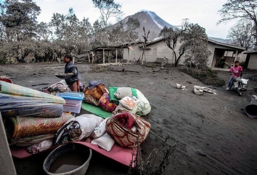 Indonesian soldiers inspect an empty village hit by Mount Sinabung's eruption, in Gamber Village, Karo, North Sumatra, Indonesia, 23 May 2016. Following the 21 May 2016 eruption of Mount Sinabung in Indonesia's North Sumatra province, thousands of people living near the volcano are experiencing res