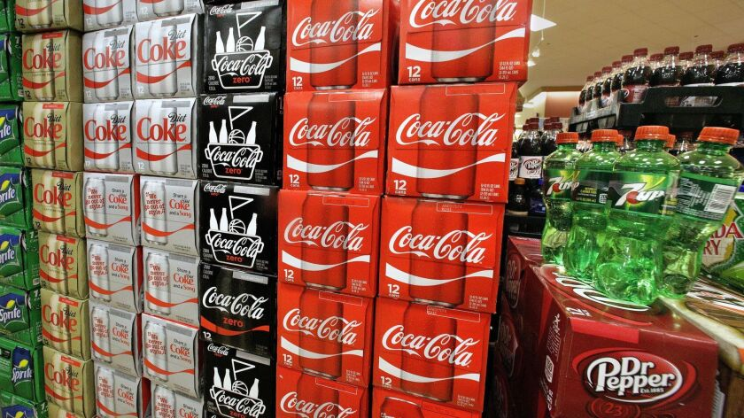 Sodas and energy drink are stacked and line the shelves in a grocery store Wednesday, May 18, 2016,