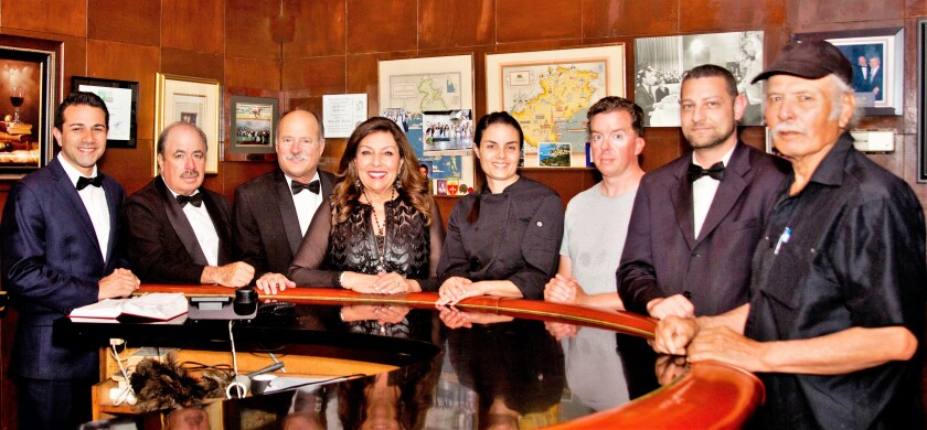The Old Trieste restaurant family includes, from left, Charles Couri, Victor Bravo, Larry and Victoria Tomicich, their daughter Nicole Tomicich Habib, Robert Kessler, David Lependorf and chef Jose Lopez.