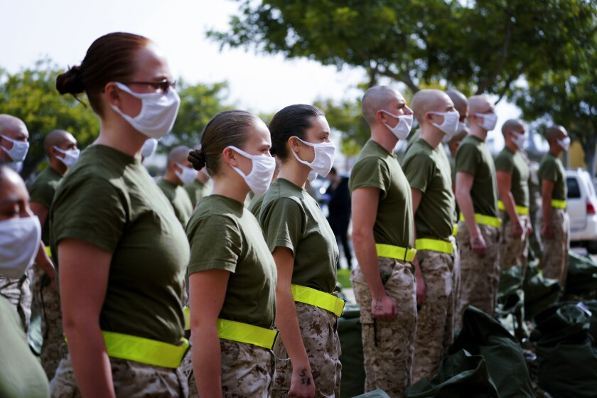 Female and male recruits stand at attention at Marine Corps Recruit Depot San Diego Feb. 9