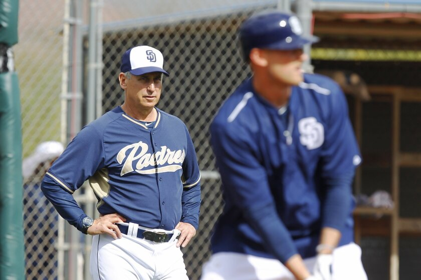 San Diego Padres manager Bud Black watches a spring training practice.