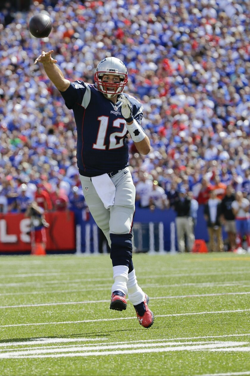 New England Patriots quarterback Tom Brady (12) throws a pass to Julian Edelman for a touchdown during the first half of an NFL football game against the Buffalo Bills, Sunday, Sept. 20, 2015, in Orchard Park, N.Y. (AP Photo/Bill Wippert)