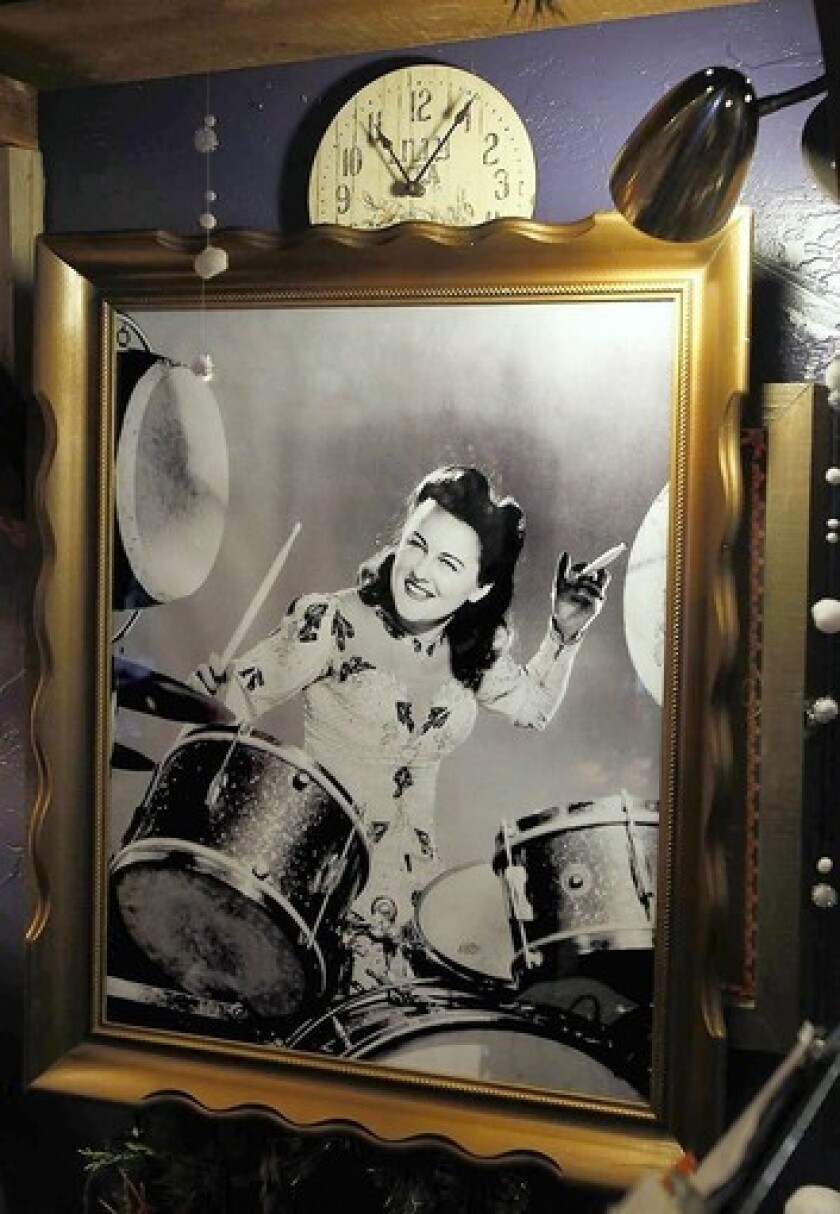 A studio publicity photo of Viola Smith playing the drums adorns the wall of the Piecemakers Country Store in Costa Mesa.