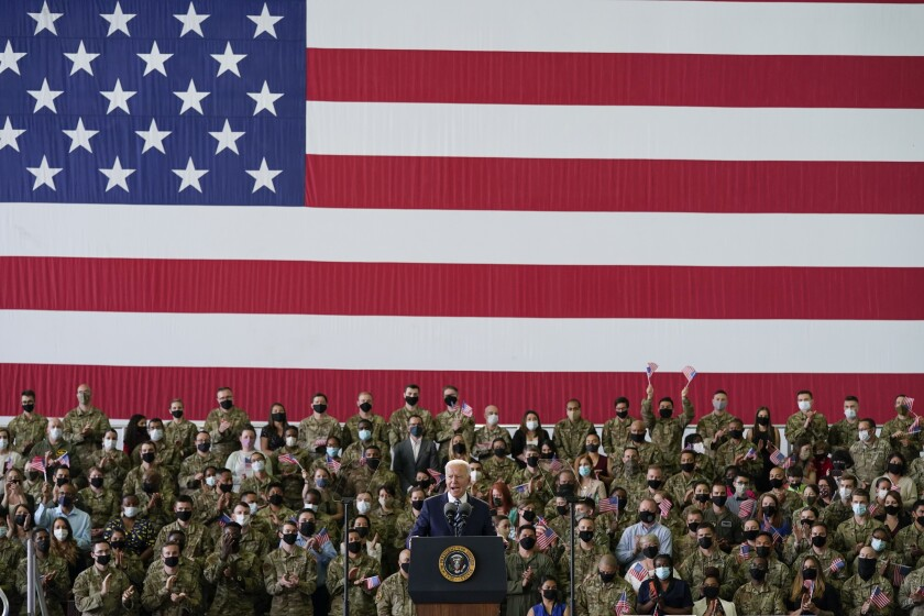 President Joe Biden speaks to American service members in England.