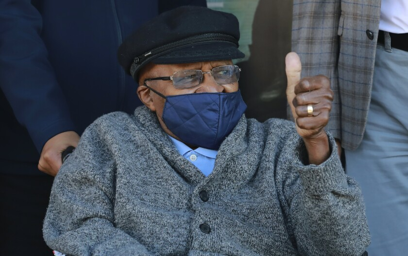 Anglican Archbishop Emeritus, Desmond Tutu gestures after receiving a shot of the COVID-19 vaccine, at the Brooklyn Chest Hospital in Cape Town, South Africa, Monday, May 17, 2021. South Africa has started its mass vaccination drive with the goal of inoculating nearly 5 million citizens aged 60 and above by the end of June. AP Photo/Nardus Engelbrecht)