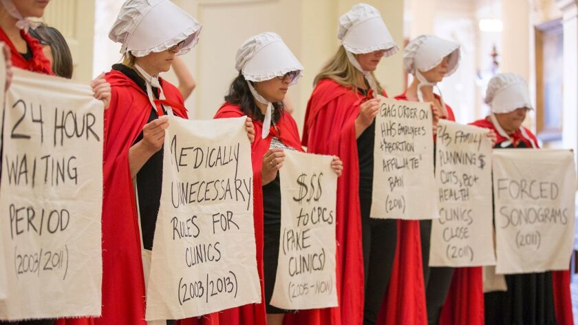 "In Austin, Texas, abortion rights activists dressed as characters from ""The Handmaid's Tale"" protest"