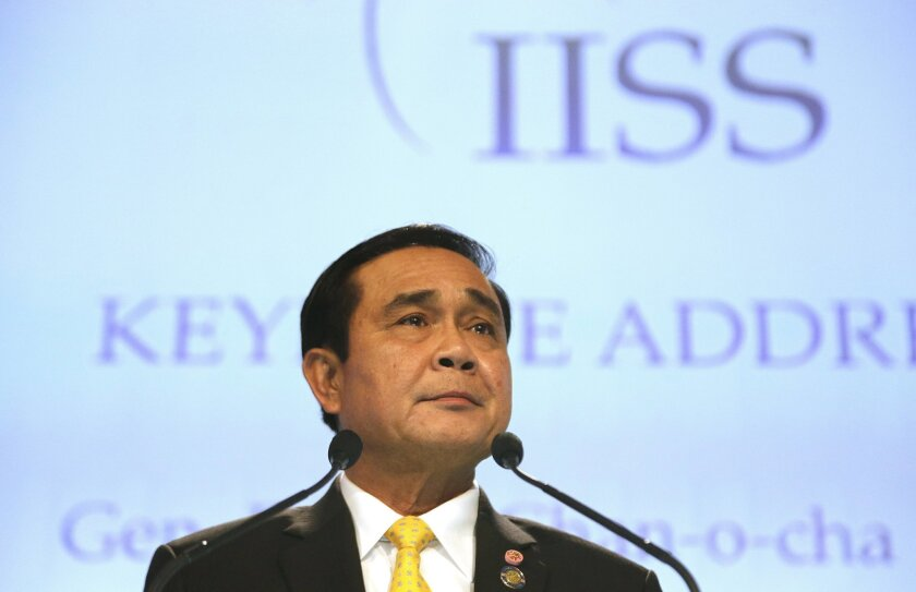Thailand's Prime Minister Prayuth Chan-ocha delivers the keynote address at the Opening Dinner of the 15th International Institute for Strategic Studies Shangri-la Dialogue, or IISS, Asia Security Summit on Friday, June 3, 2016, in Singapore. (AP Photo/Wong Maye-E)