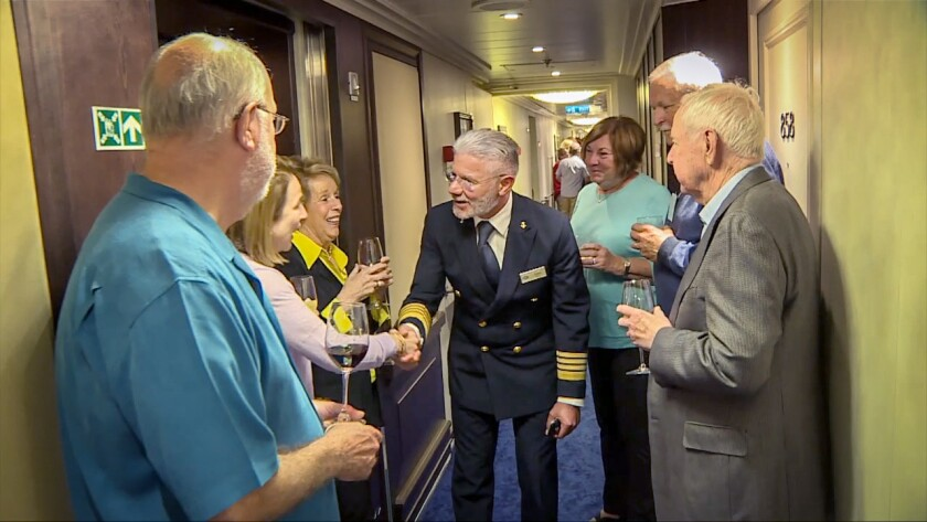 Rosario Giovanni Vasta greets passengers during a Block Party aboard Regent Seven Seas Cruises' ship