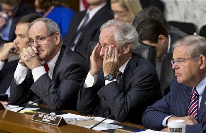 From right to left, Senate Foreign Relations Chairman Robert Menendez, D-N.J., Sen. Bob Corker, R-Tenn., the ranking member, Sen. James Risch, R-Idaho, and Sen. Marco Rubio, R-Fla., listen to testimony from Secretary of State John Kerry, and Defense Secretary Chuck Hagel at a hearing on President Barack Obama's request for congressional authorization for military intervention in Syria, a response to last month's alleged sarin gas attack in the Syrian civil war, on Capitol Hill in Washington, Tue