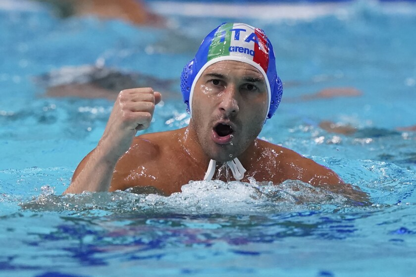 Italy's Pietro Figlioli celebrates after a score against the United States during a preliminary round men's water polo match at the 2020 Summer Olympics, Thursday, July 29, 2021, in Tokyo, Japan. (AP Photo/Mark Humphrey)