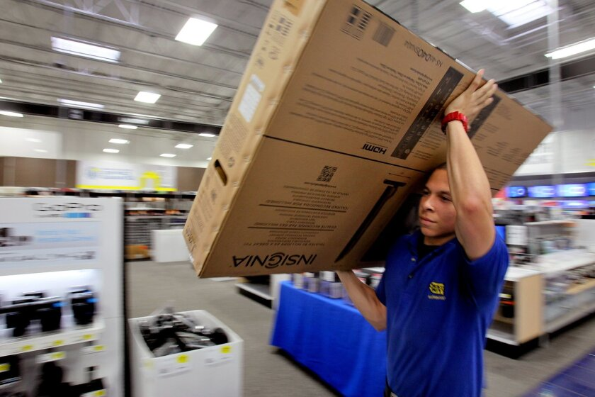 At Best Buy in Mission Valley, employee Jacob Samuel carries a just-purchased TV for a customer on Black Friday. Best Buy's Reward Zone program offers members a $5 reward certificate for every 250 points earned with in-store purchases. Another perk is the retailer's free product setup helpline for Premier Silver members of the program.