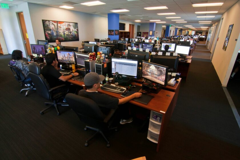 A study found an increase in San Diego area help wanted ads for Internet/technology jobs. The above file photo shows workers at Legend3D, which converts 2D movies to 3D.