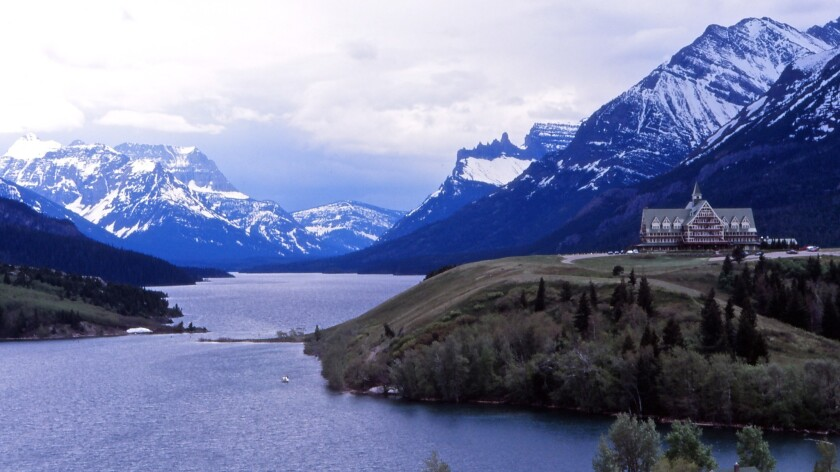 The Prince of Wales Hotel, part of Canada's Waterton Lakes National Park, stands just north of the border from Montana's Glacier National Park.