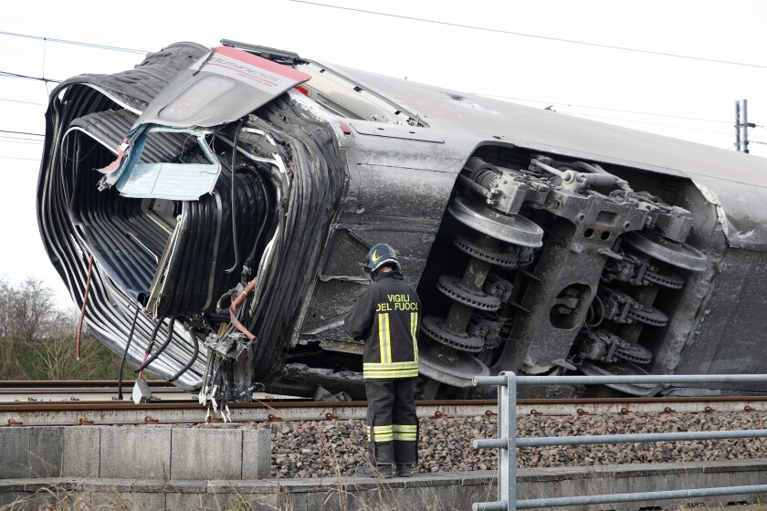 A firefighter at the scene of a train derailment near Lodi, Italy, on Thursday.
