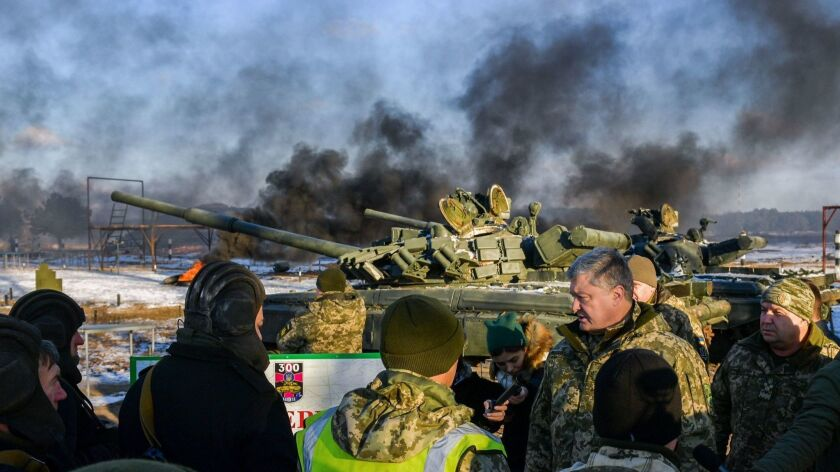 President Petro Poroshenko talks with tank operators during drills near the city of Chernihiv in northern Ukraine on Wednesday.