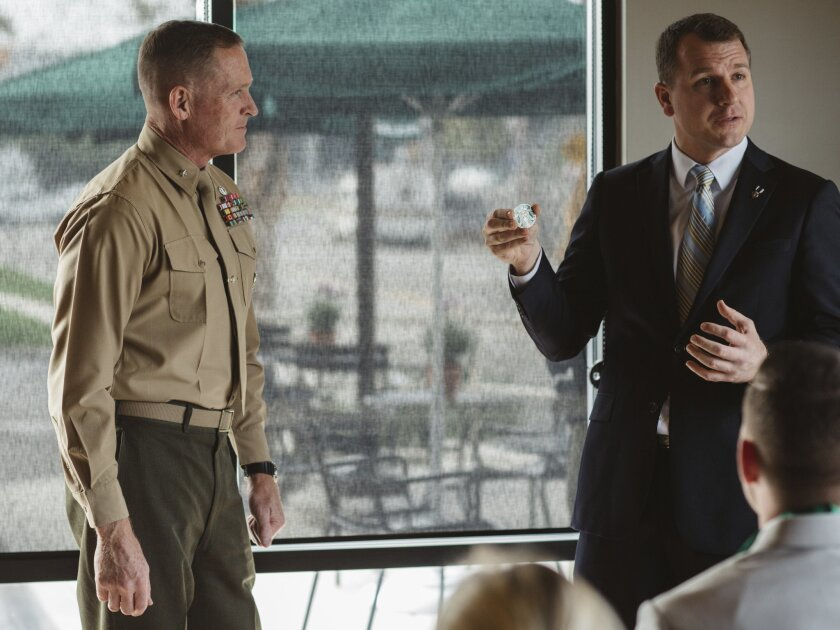 Brig. Gen.Edward Banta, Camp Pendleton's commanding general meets veteran Timothy Bomke head of veteran and military affairs for Starbucks at the dedication of a Starbuck's Military Family store at 1779 Oceanside Blvd. in Oceanside. The two participated in a challenge coin exchange to show mutual support for the project. Banta received a Starbucks coin, and in exchange Bomke, representing Starbucks, received a Camp Pendleton military coin.