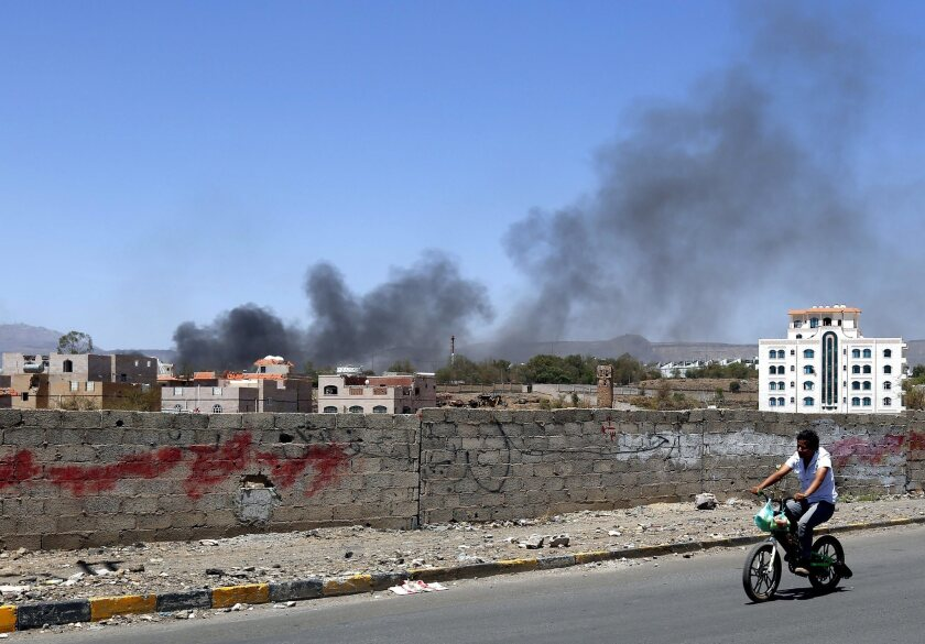 Smokes rises from a Houthi rebel-controlled army camp after a Saudi-led coalition airstrike in Sana, Yemen.