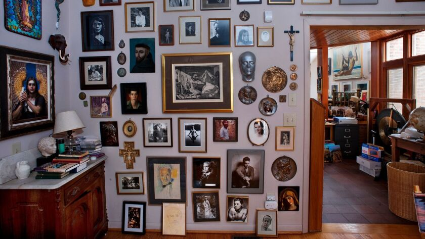 A wall of framed art belonging to Price; detail of the original photo.