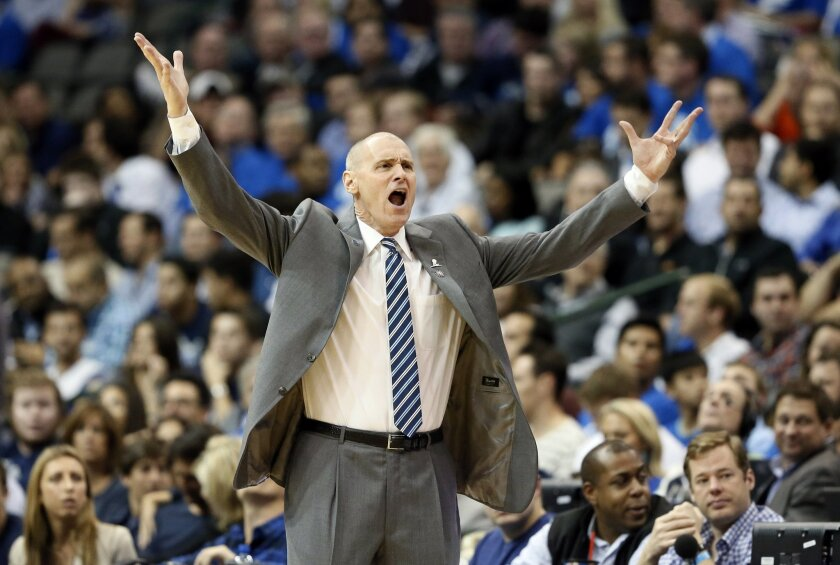 Dallas Mavericks head coach Rick Carlisle reacts after his team was charged a foul in the second half of an NBA basketball game against the Toronto Raptors Tuesday, Nov. 3, 2015, in Dallas. The Raptors won 102-91. (AP Photo/Tony Gutierrez)