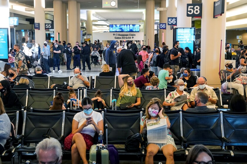 Travelers at Los Angeles International Airport in October 2020