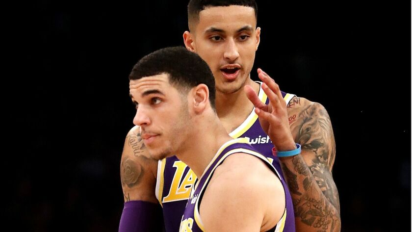 LOS ANGELES, CALIF. - DEC. 5, 2018. Lakers guard Lonzo Ball is congratulated by teammate Kyle Kuzma