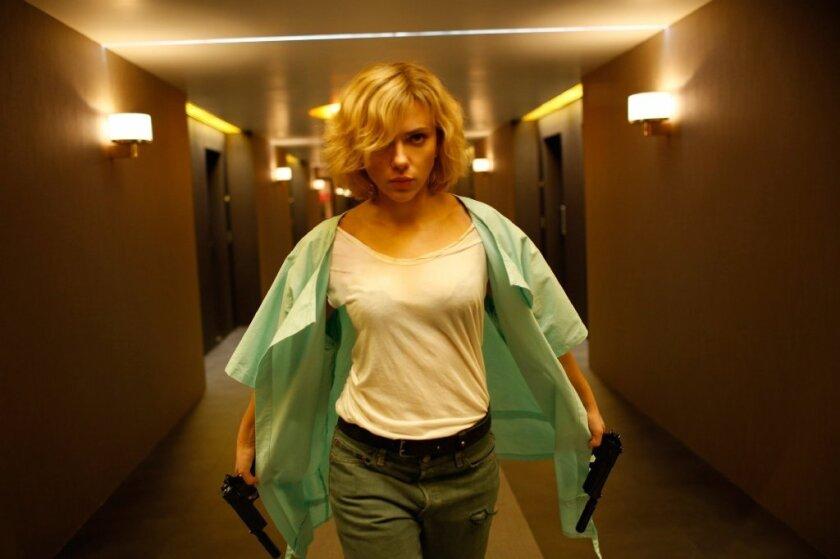 "Scarlett Johansson's ""Lucy"" had both guns blazing at the box office."