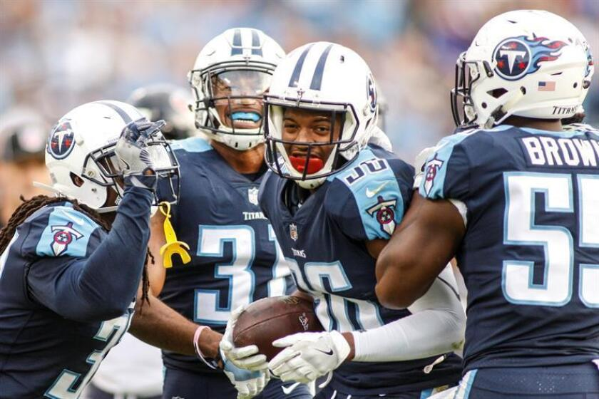 Tennessee Titans corner back LeShaun Sims, 36, with the ball celebrates making an interception that sealed the game against the Houston Texans during the second half of their NFL game at Nissan Stadium in Nashville, Tennessee, USA, 3 December 2017. Titans won the 24-13. EFE