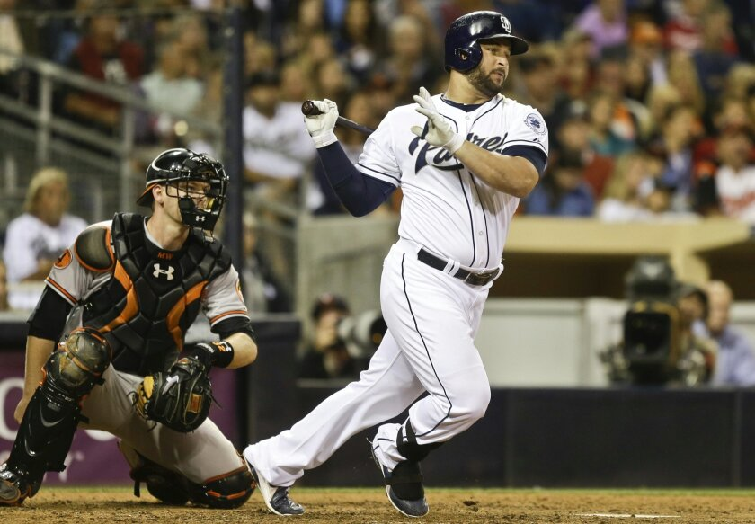 Yonder Alonso singles in a run in the sixth inning against the Orioles on Tuesday.