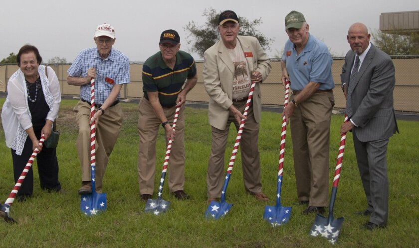 From left, Faye Jonason, Cal Frantz, Gerald Polyascko, James Williams, Richard Rothwell and Bill Birnie pose for a ceremonial groundbreaking photo at the location for a memorial dedicated to Staff Sgt Reckless on Camp Pendleton. (U.S. Marine Corps photo by Cpl. Brian Bekkala)