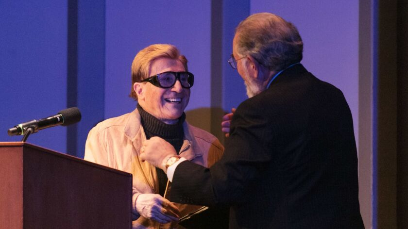 John Rechy receives the Kirsch Award for lifetime achievement at the L.A. Times book prizes in April 2018.