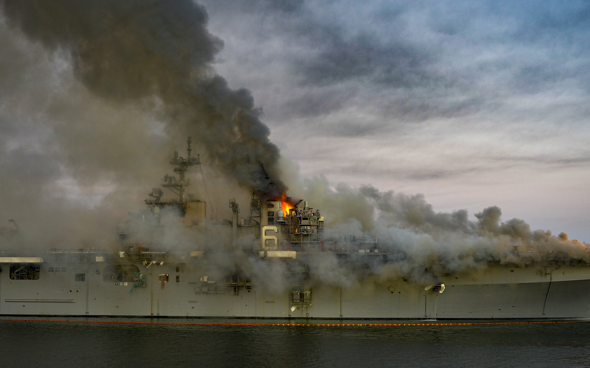 A fire continues to be fought into the evening on board the amphibious assault ship USS Bonhomme Richard.