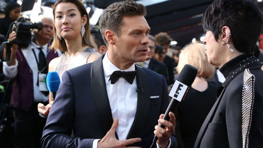 What, Harvey Weinstein was unavailable? The fact that E! had Ryan Seacrest, seen interviewing songwriting legend Diane Warren, on the red carpet in 2018 should go down as a Hollywood scandal in itself.