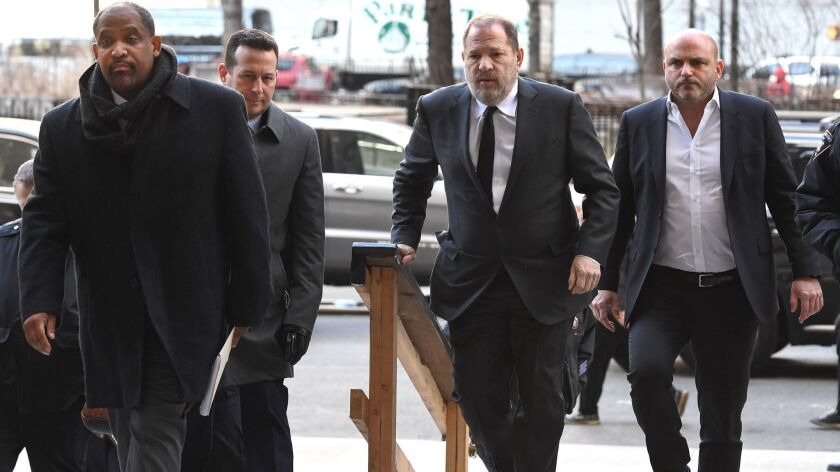 Harvey Weinstein arrives at the State Supreme Court with his new lawyers, Ronald Sullivan and Jose Baez, in New York, NY on Jan. 25.
