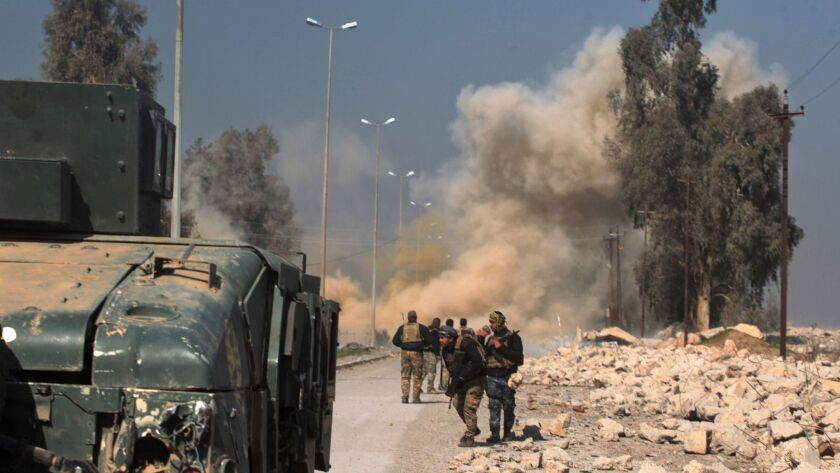Smoke billows as Iraqi forces attack Mosul airport during an offensive to retake the area from Islamic State.
