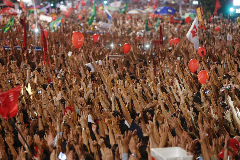 On Friday, thousands in Sao Paulo, Brazil, attended a rally in support of Brazil's President Dilma Rousseff and former President Luiz Inacio Lula da Silva.