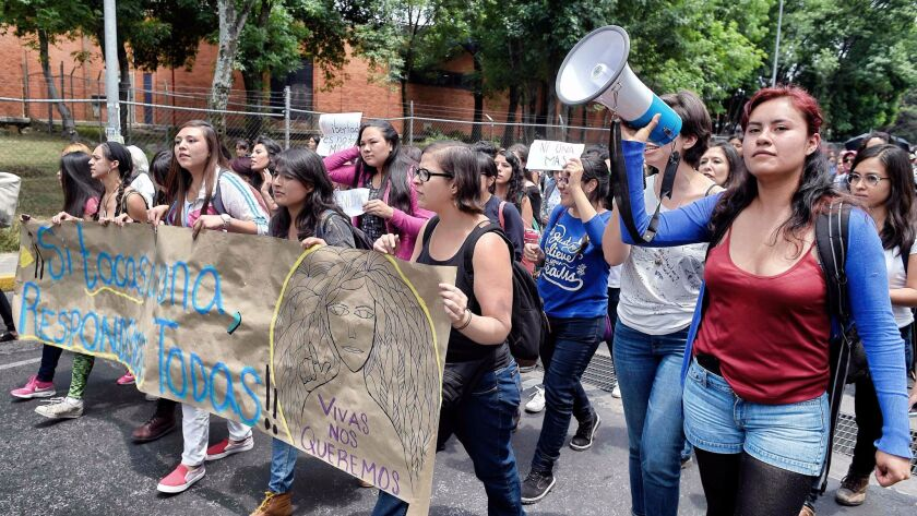 Women protest the killing of former student Lesby Berlin Osorio outside the Faculty of Political and