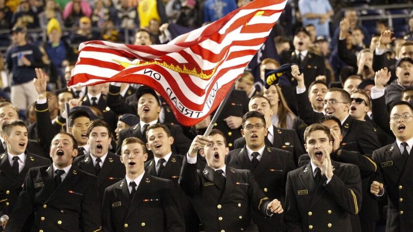 Navy midshipmen start to sing for their team late in the fourth quarter.