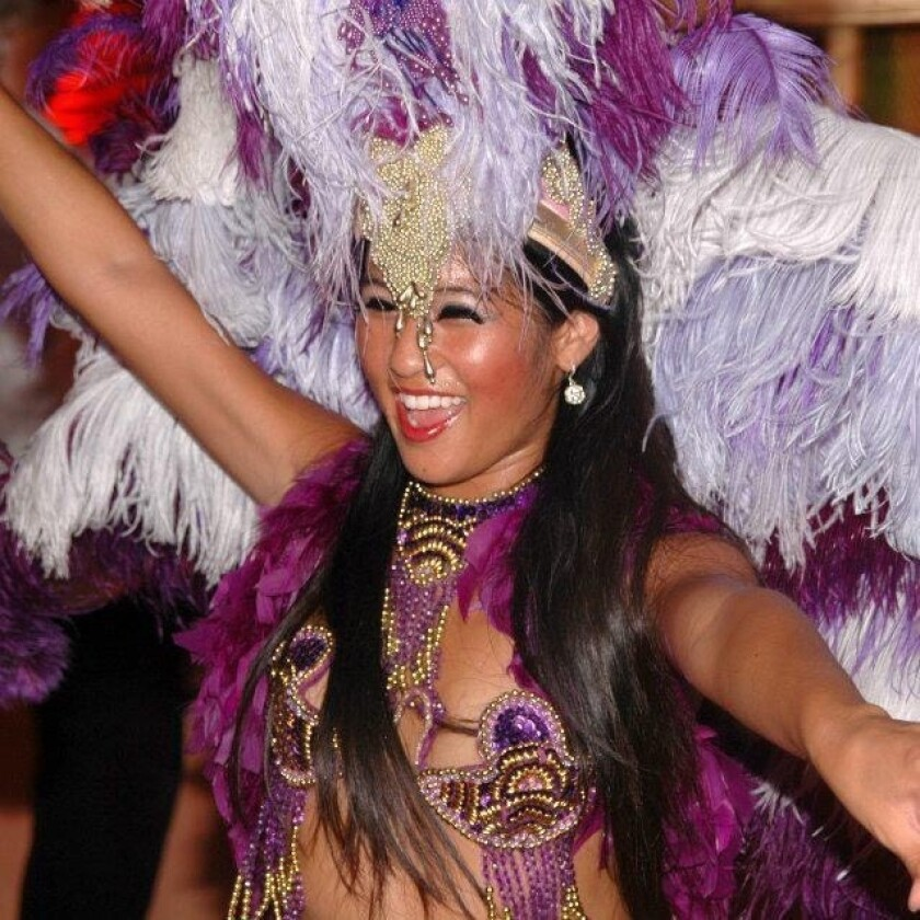 Susie Grafte participates in the Brazilian Day parade with her samba group.