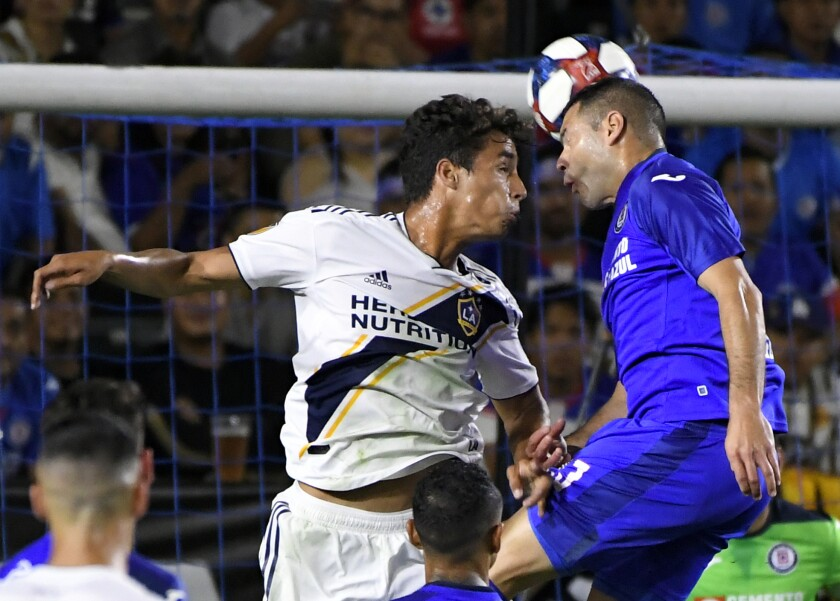 The Galaxy's Ethan Zubak, left, and Cruz Azul's Pablo Aguilar battle for the ball during Tuesday's match.