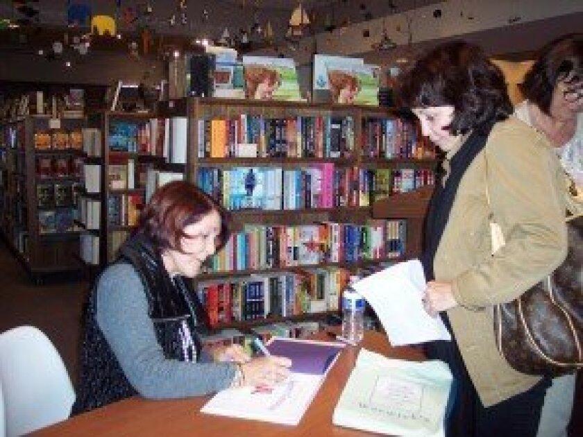 Jenny Craig signs books.