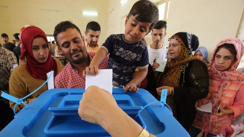 Iraqi Kurds casts their votes in the Kurdish independence referendum in the city of Kirkuk in northe
