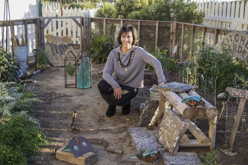 La Jolla artist Becky Guttin in the garden she enhanced with repurposed sculptures made of cornhusks, glass, tools, compacted radiators and other detritus connected in some way to the area's history.