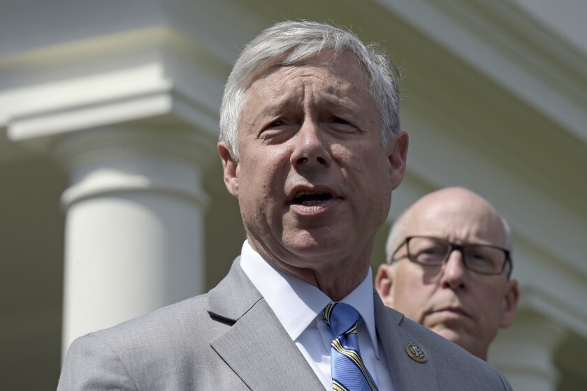"""FILE - In this May 3, 2017, file photo, Rep. Fred Upton, R-Mich., left, speaks to reporters outside the White House in Washington. Upton, said he doesn't support a formal impeachment inquiry against President Donald Trump. But he has no problem with Democratic-led committees digging for more information. Upton told the Detroit Economic Club that """"we need to know what the answers are."""" He shared the stage Wednesday, Oct. 2, 2019 with Democratic Rep. Debbie Dingell. (AP Photo/Susan Walsh, File)"""
