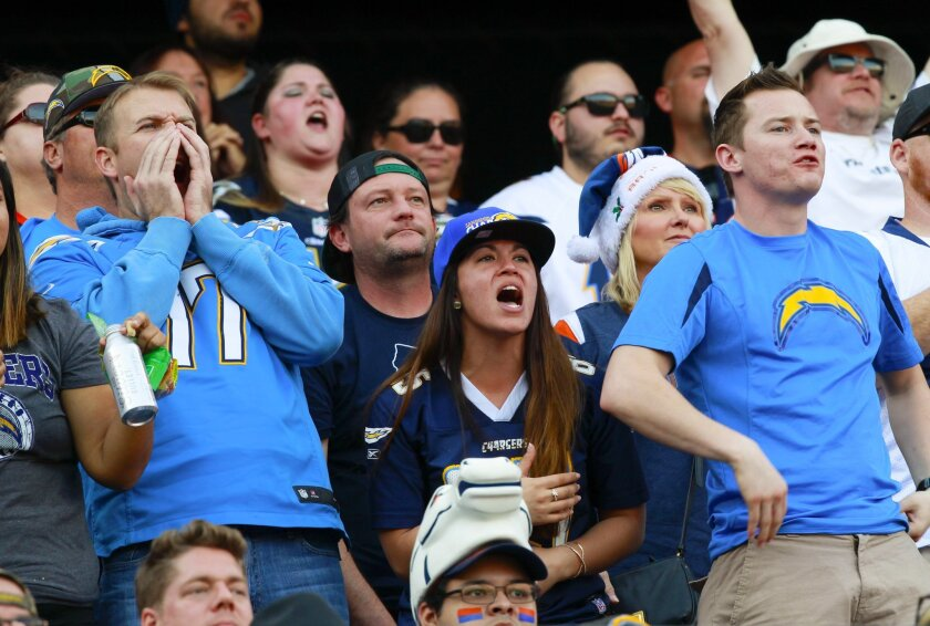 Chargers fans show their disbelief in the officials penalty ruling as the chargers fall to the Denver Broncos at Qualcomm Stadium.