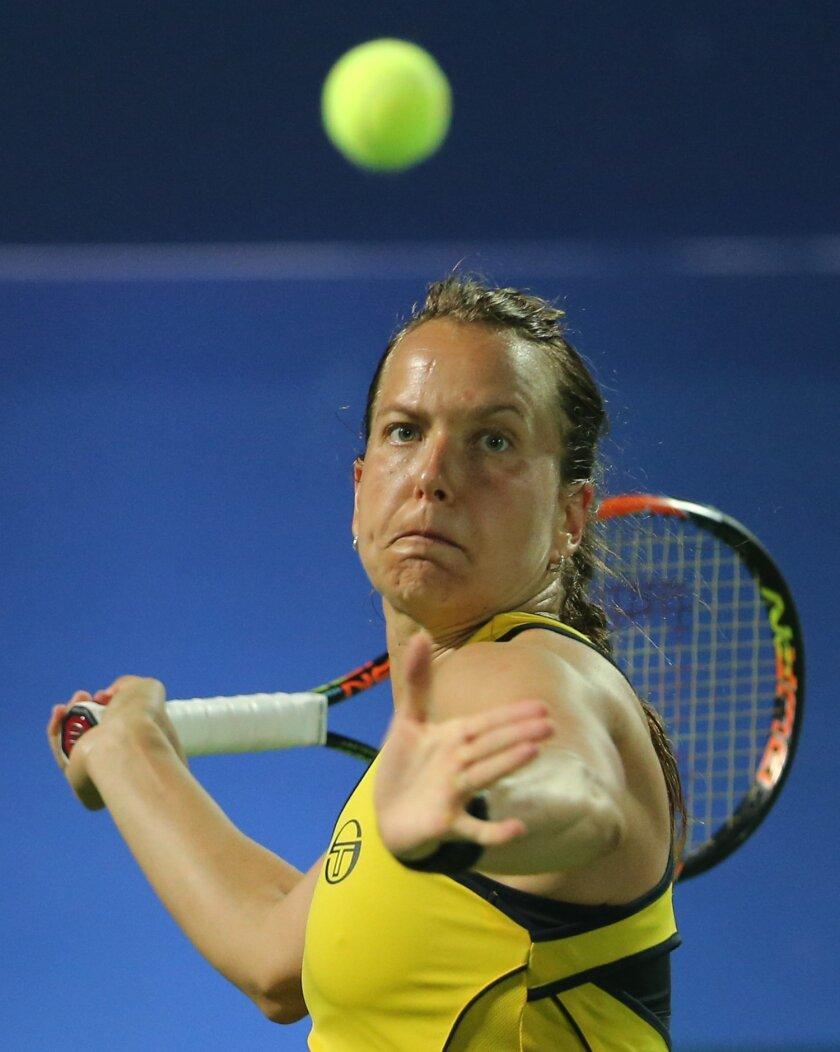 Barbora Strycova of Czech Republic returns the ball to Caroline Garcia of France during the semi final match of the Dubai Tennis Championships in Dubai, United Arab Emirates, Friday, Feb. 19, 2016. (AP Photo/Kamran Jebreili)